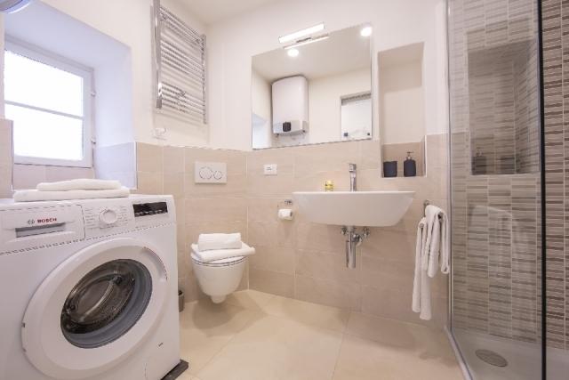 large bathroom with washing machine
