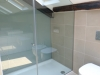 eaves bathroom with walk-in shower