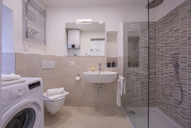 large bathroom with washing machine