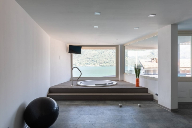 gym with lake view jacuzzi